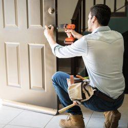 Handyman fixing a door