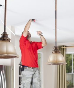 Man installing lighting
